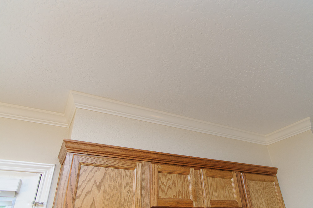 Crown molding over cabinets